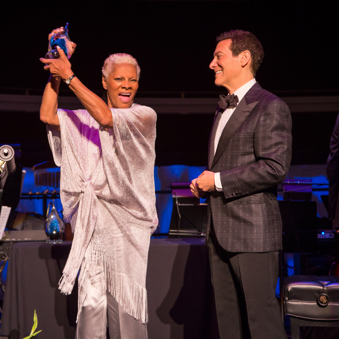 Dionne Warwick proudly holds her Songbook Hall of Fame award next to Michael Feinstein.