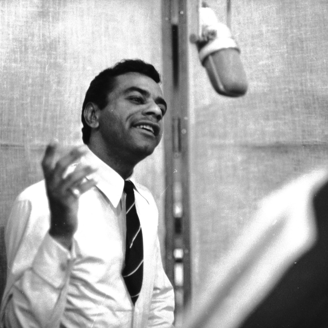 Johnny Mathis in the recording studio sings into a microphone.