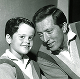 "Donny Osmond and Andy Williams chat during a mid-1960s episode of ""The Andy Williams Show."""