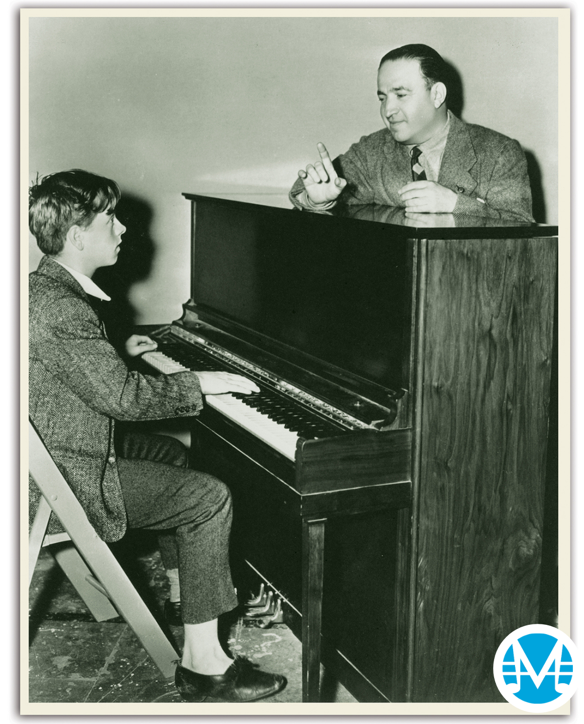 Gus Kahn instructs a young Mickey Rooney to play piano.